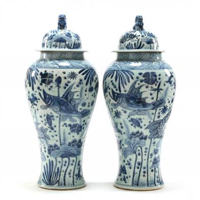 pair-of-large-palace-blue-and-white-covered-urns