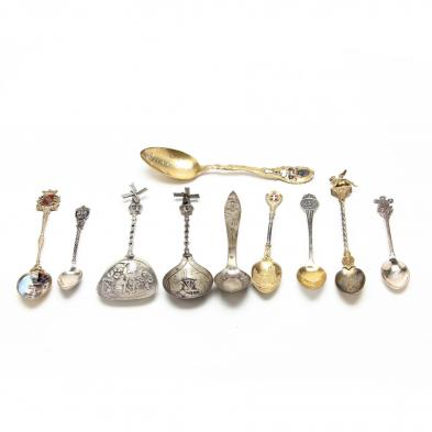group-of-silver-souvenir-spoons
