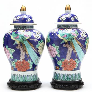 a-pair-of-blue-floral-covered-jars