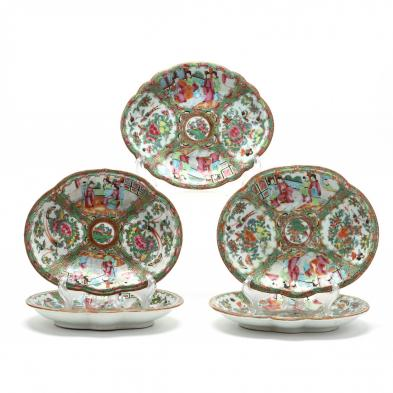 a-group-of-five-oval-serving-plates