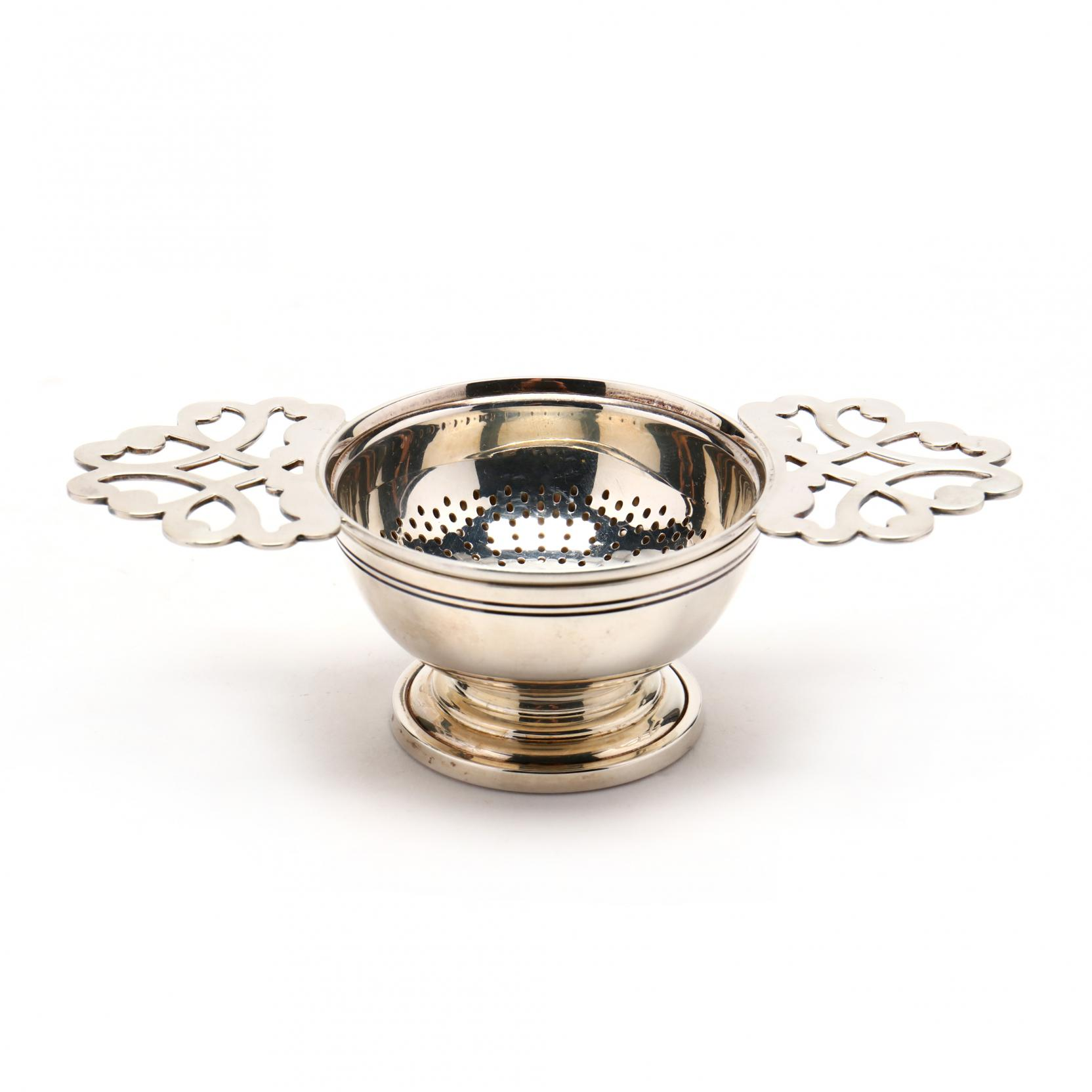 an-elizabeth-ii-silver-tea-strainer-with-stand