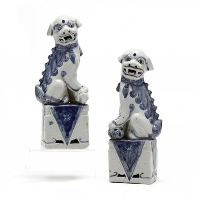 a-pair-of-chinese-blue-and-white-porcelain-foo-dogs