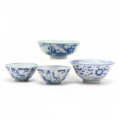 a-group-of-four-asian-blue-and-white-bowls