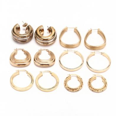 five-pairs-of-gold-hoop-earrings-and-one-pair-of-gold-tone-hoop-earrings