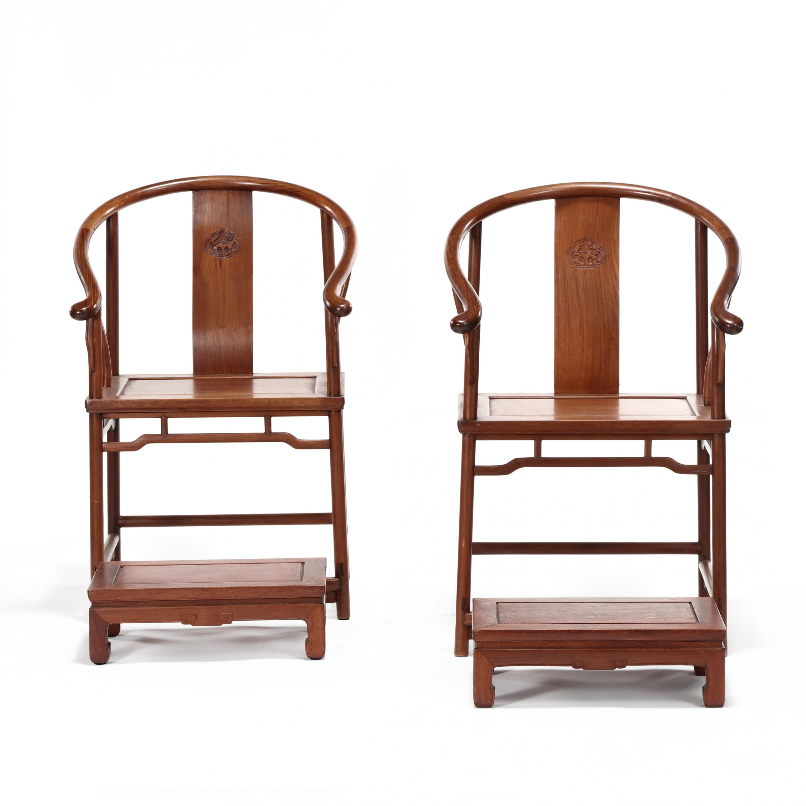 a-pair-of-chinese-teak-chairs-with-footstools
