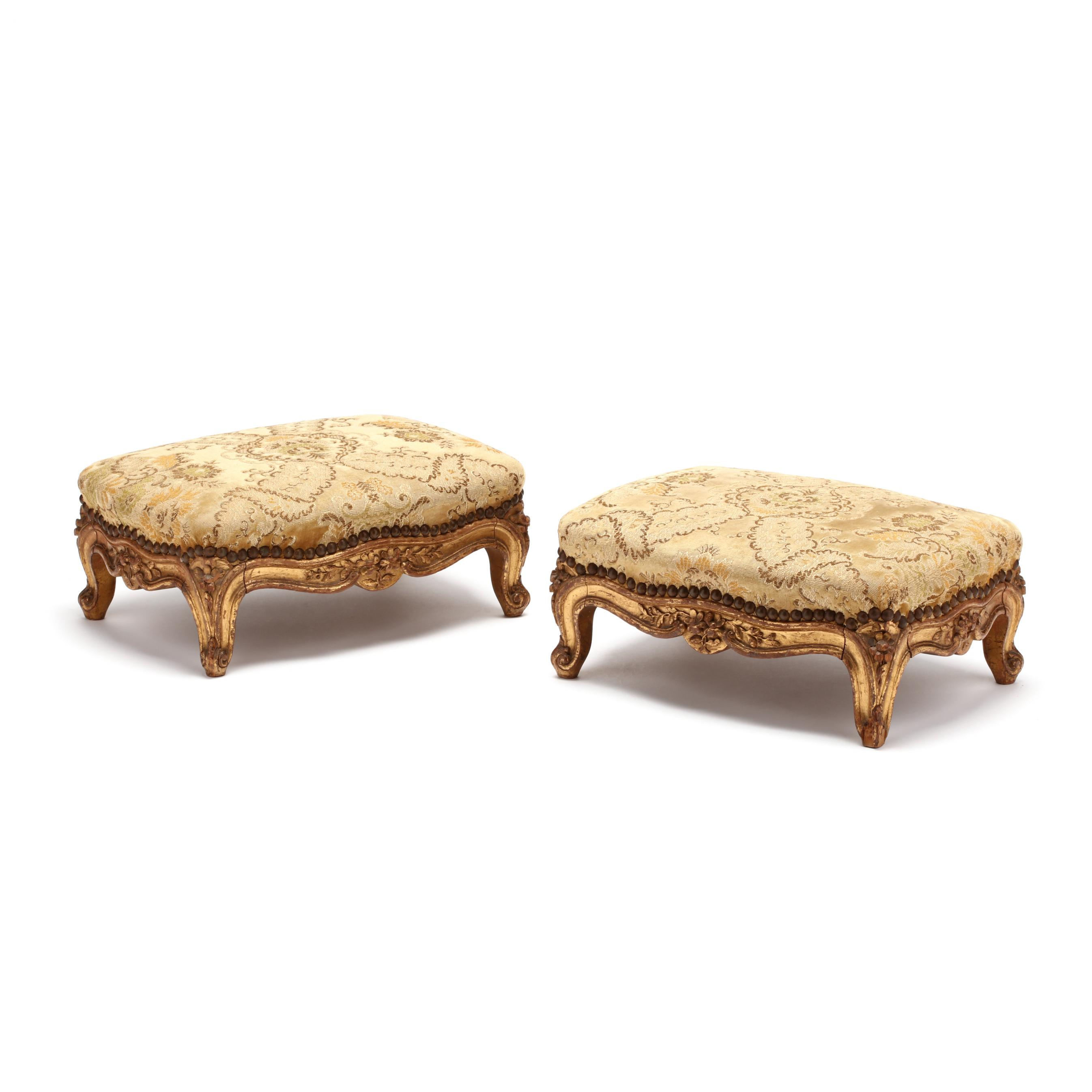 pair-of-antique-louis-xv-style-carved-and-gilt-footstools